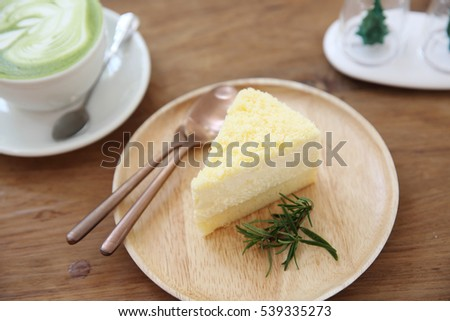 cheesecake japanese style with green tea on wood background