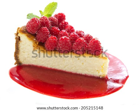 Cheesecake slice with fresh raspberries and mint isolated on white - stock photo