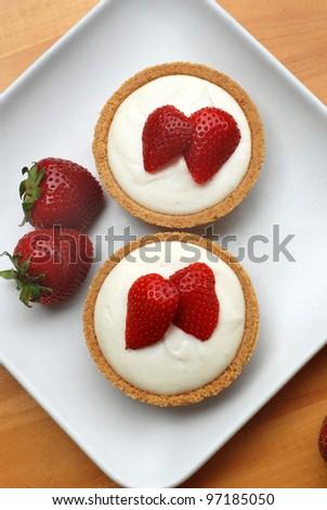 cheesecake tarts with strawberries - stock photo