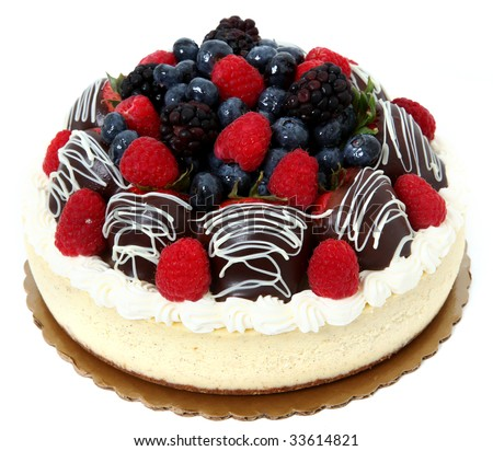 Cheesecake topped with fresh berries and chocolate dipped ganache strawberries. Cheese cake over white. - stock photo