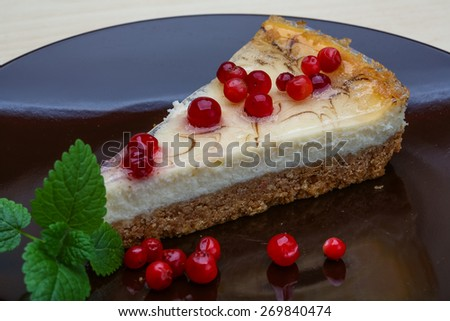 Cheesecake with berries and fresh mint branch