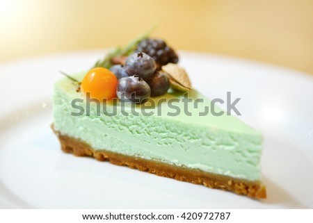 Cheesecake with berries on a light background