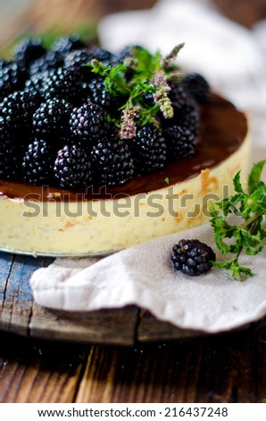 Cheesecake with chocolate and blackberries - stock photo