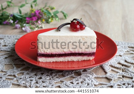 Cheesecake with fresh red currants on a beige background - stock photo