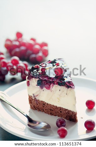 Cheesecake with grapes and forest fruits - stock photo