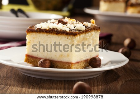 cheesecake with nuts on plate, dark background, selective focus - stock photo