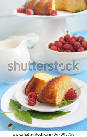 Cheesecake with oatmeal and fresh raspberry on rustic blue table - stock photo