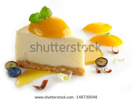 cheesecake with peaches and blueberries on white background - stock photo