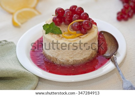 Cheesecake with red berry sauce