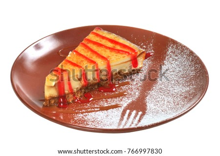 cheesecake with sauce on white background