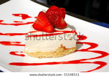 Cheesecake with strawberries on a white plate