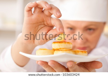 cheesecakes on a white platter and cheese - stock photo