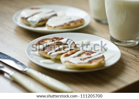 Cheesecakes with milk and sour cream. Yummy dessert