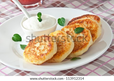 Cheesecakes with mint and sour cream. Yummy dessert - stock photo