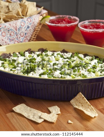 cheesy dip, chips, and margaritas - stock photo