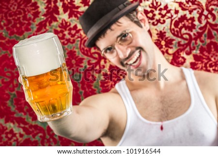 Cheesy man toasting to you in wife beater hat glasses and mustache, frothy light ale at fancy retro bar - stock photo