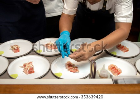 Chef arrangement food on plate - stock photo