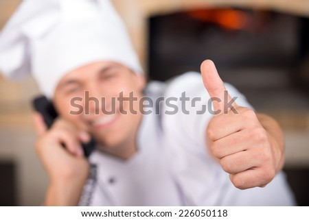 Chef baker in white  uniform. Close-up. - stock photo