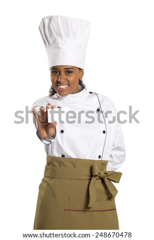 Chef, baker or cook woman showing blank sign card wearing chefs uniform and hat. Blank card for menu, gift card, offer etc Beautiful african / black female isolated on white background - stock photo