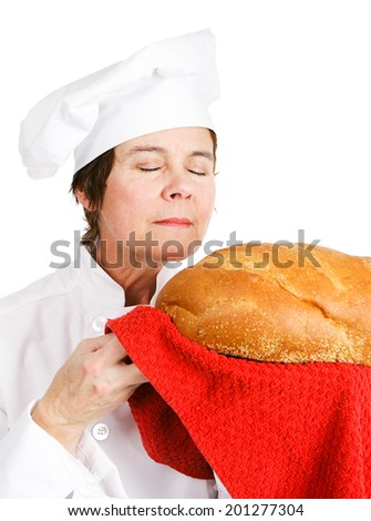 Chef baker smelling fresh baked bread.  Isolated on white.