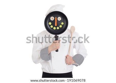 Chef behind pan. Isolated on white background. Funny image - stock photo