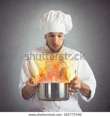 Chef blowing his burnt food in pot - stock photo