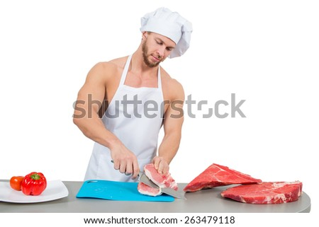 chef bodybuilder preparing large chunks of raw meat. - stock photo