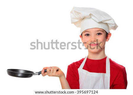 Chef boy holding frying pan isolated on white background   - stock photo