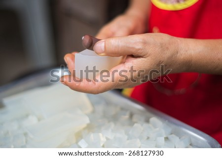 Chef chopping a gelatin on stainless tray - stock photo