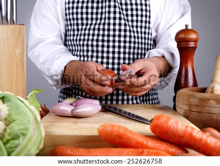 chef chopping shallots or onions - stock photo