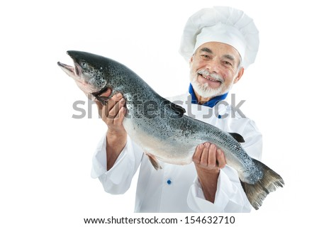 Chef cook holding a big atlantic salmon fish isolated on white background - stock photo