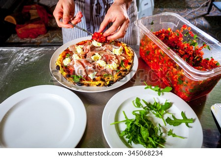Chef cooking a gourmet dish close-up - stock photo
