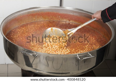 chef cooking beans at commercial kitchen-bean - stock photo