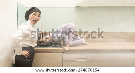 chef cooking child on fire, funny situation - stock photo