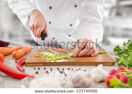 Restaurant Kitchen Hand chef cooking food kitchen restaurant cutting stock photo 562219663