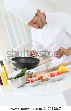 Chef cooking in dosmetic kitchen