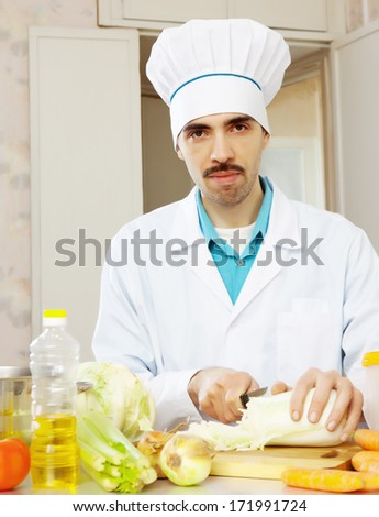 chef cooking lettuce on cutting board  - stock photo