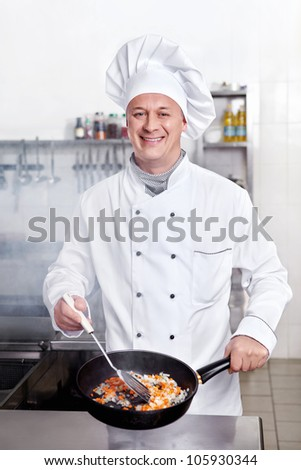 Chef cooks in the kitchen