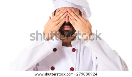 Chef covering his eyes over white background - stock photo