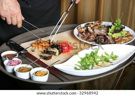chef cutting vegetables looking from front - stock photo