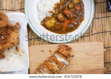 Chef decorated Japanese pork curry with steam rice / cooking Japanese pork curry paste concept - stock photo