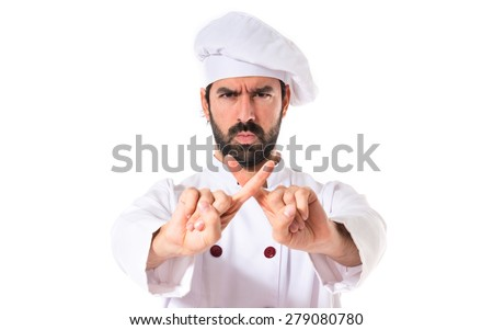 Chef doing NO gesture over white background - stock photo