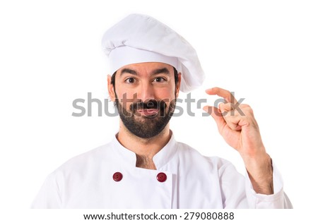 Chef doing tiny sign over white background - stock photo