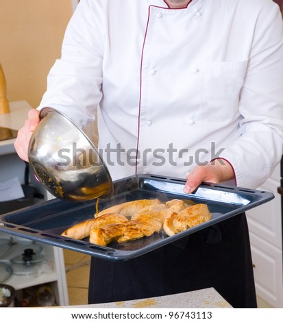 Chef frying chicken fillet