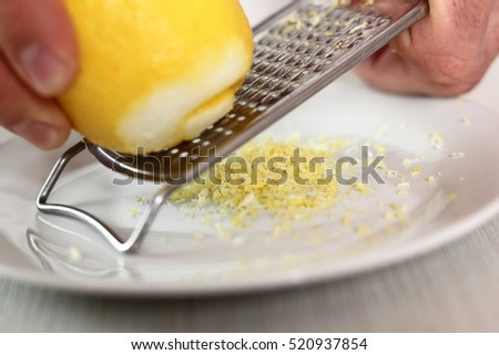 Chef grating lemon rind. Making Chicken and Egg Galette Series.