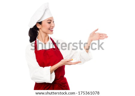 Chef greeting the customers and directing them the way - stock photo