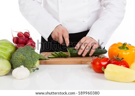 Chef hands cutting fresh vegetables - stock photo