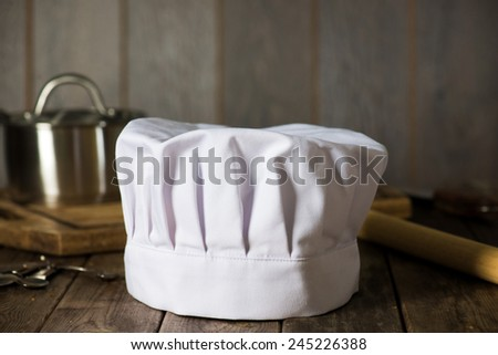 chef hat with kitchen settings and rustic look  - stock photo
