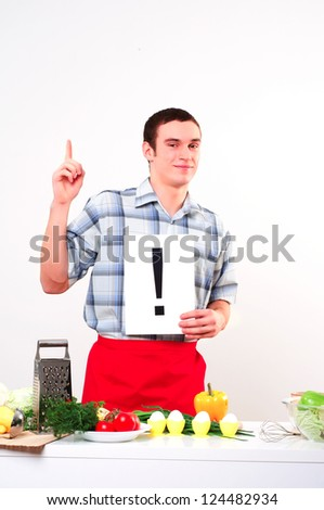 Chef holding a plate with an inscription exclamation mark - stock photo