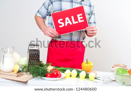 Chef holding a plate with an sale mark - stock photo